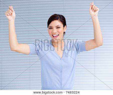 Successful Businesswoman Punching The Air In Celebration