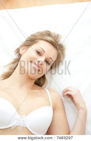 Radiant Woman In Underwear Lying On Bed