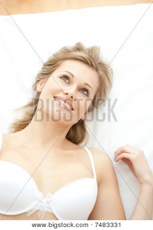 Bright Woman In Underwear Lying On Bed