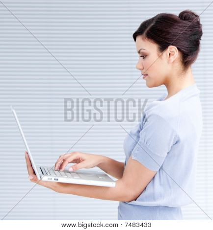 Confident Businesswoman Using A Laptop