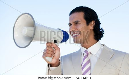 Latin Business Man Shouting Through A Megaphone