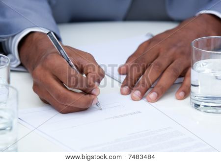 Close-up Of Ambitious Business Man Signing A Contract