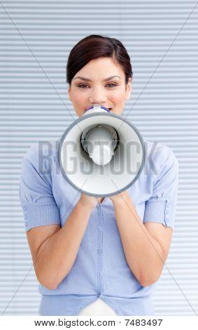 Positive Businesswoman Yelling Through A Megaphone