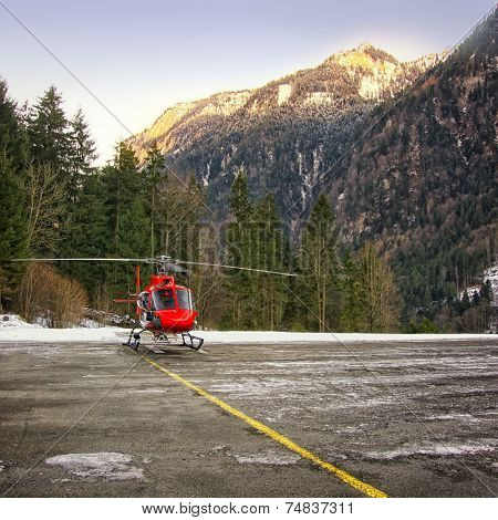 Red Helicopter Landed At Swiss Heliport At Jungfrau Region