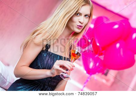 Woman partying in night club