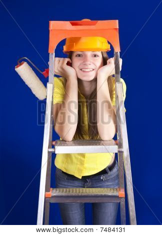 Girl With Paint Rollers On Stepladder