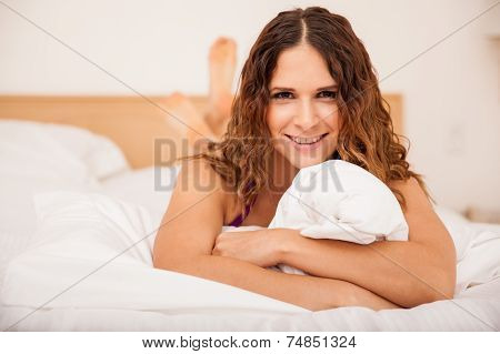 Cute Brunette Relaxing In A Bed