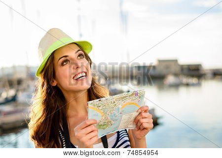 Tourist With Map On Summer Travel By The Harbor