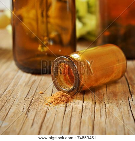 closeup of a bottle with dehydrated royal jelly on a rustic wooden table