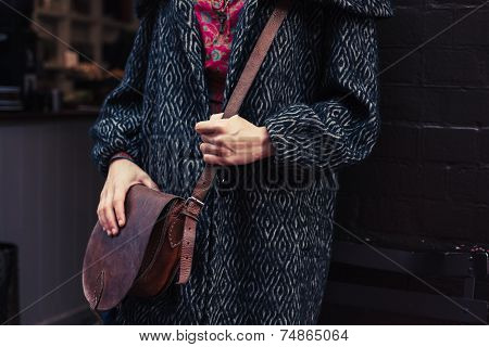 Woman In Winter Coat With Shoulder Bag