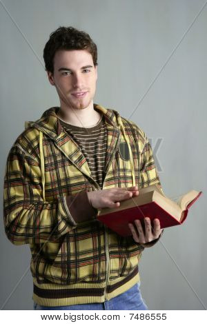 Young Student Boy With Open Book In Hands