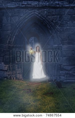 Ghost holding lantern in the archway of an ancient abbey