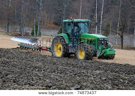 John Deere 8100 Agricultural Tractor And Kverneland Pb100 Plough On Field