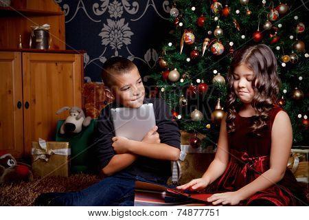 Little Children Opening A Christmas Present