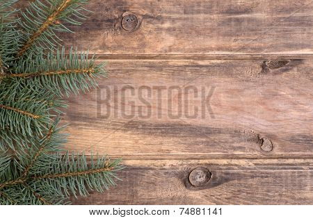 Christmas decoration with fir and wooden background