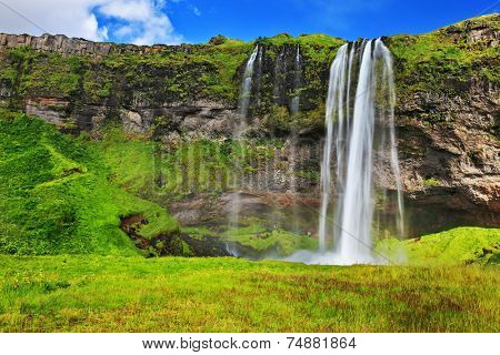 Typical landscape for the summer in Iceland. Multi waterfall Seljalandsfoss