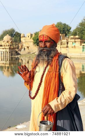 JAISALMER, INDIA - NOVEMBER 28, 2012: Holy Sadhu men with traditional painted face in Jaisalmer, India.