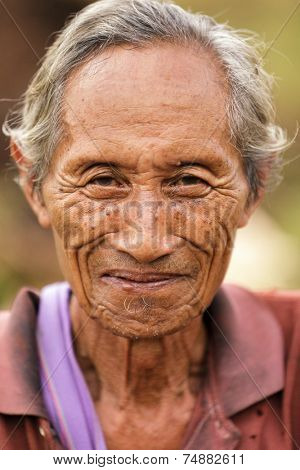 UMPHANG, THAILAND, NOVEMBER 30 : close portrait of an elderly Karen tribe man, Thai ethnicity, near the village of Umphang, north Thailand on November 30, 2012