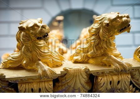 LONDON - April 06: Detail of Gold Lions on Ship in National Maritime Museum, London, England on April 06, 2014