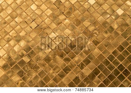 A golden tiles of a golden stupa in Wat Phra Kaew, Thailand