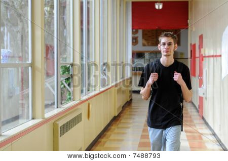 Student Walking In Hallway