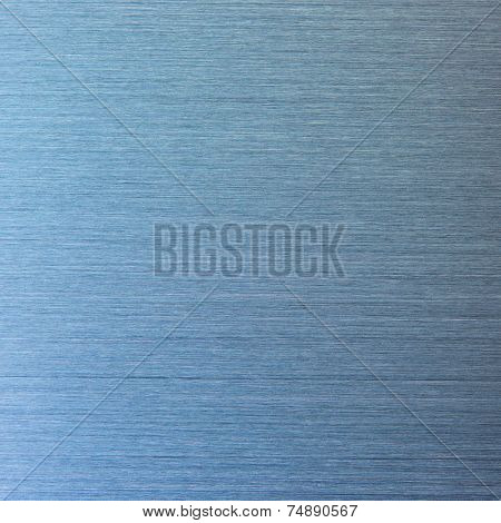 Photo of a real brushed metal texture,  in blue light.