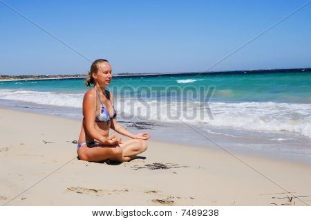 Young Beautiful Girl On The Beach