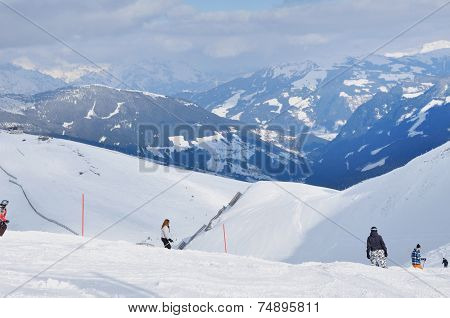 Skiers Skiing On The Piste In The Alps