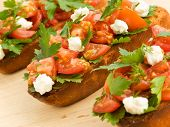 picture of italian food  - Bruschetta with cherry tomatoes cottage cheese and parsley - JPG