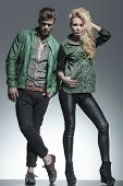 stock photo of hunk  - Full body image of a fashion couple posing for the camera - JPG