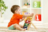 picture of boys  - child boy playing with counter toy at home - JPG
