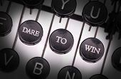stock photo of daring  - Typewriter with special buttons dare to win - JPG