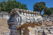 stock photo of ionic  - Part of the capitals Ionic columns in the temple of Apollo in Didim - JPG