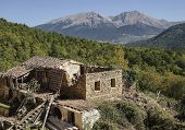 stock photo of sag  - A ruined out leaning old abandoned house on mountain in Greece