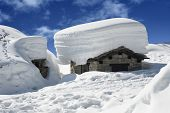 stock photo of chalet  - old alpine chalet snowbound in winter season - JPG