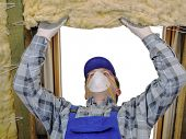 image of attic  - Worker thermally insulating a house attic using mineral wool - JPG