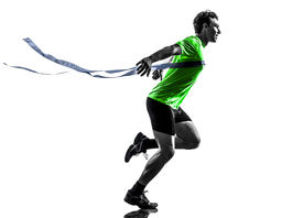 stock photo of sprinters  - one  man young sprinter runner running winner at finish line in silhouette studio on white background - JPG