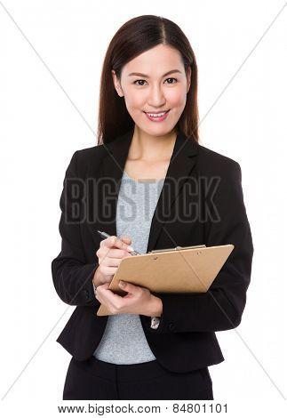 Businesswoman write on notepad
