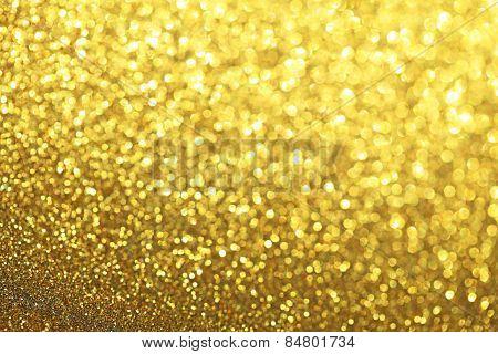 Golden Glittery Defocused Light Background