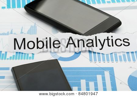 Mobile Phone And Analytics Text On Paper