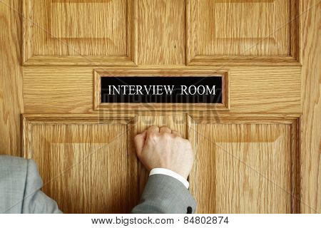Businessman knocking on interview room door concept for recruitment or medical checkup with a consultant