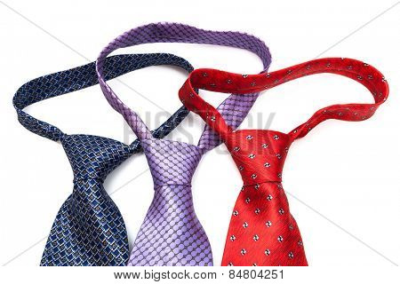 ties knotted on a white background