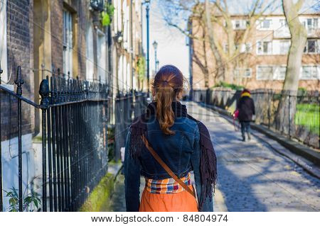 Woman Walking Cobbled Street