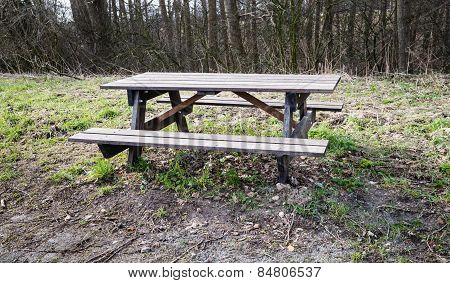 Empty Wooden Picnic Bench And Table In The Roadside At The Forest