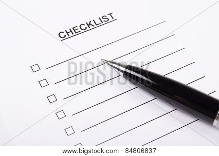 Close Up Of Blank Checklist And Pen
