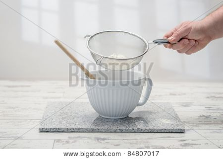 Baking bowl with sifted flour in the kitchen