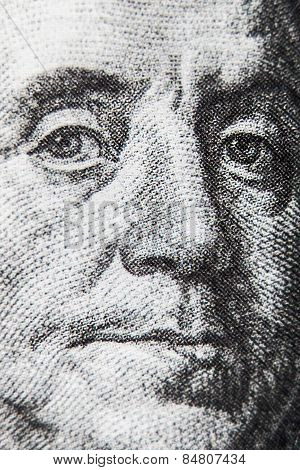 macro of 100 dollar bill with Benjamin Franklin portrait