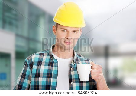 Worker on a break drinking coffee and having a rest