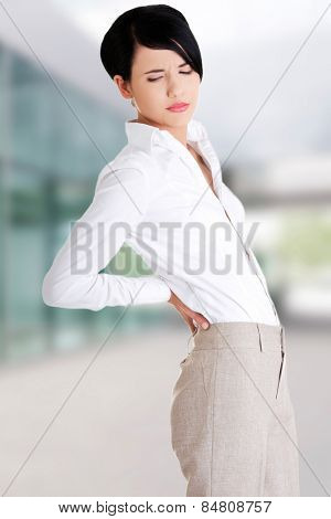 Beautiful woman with back pain