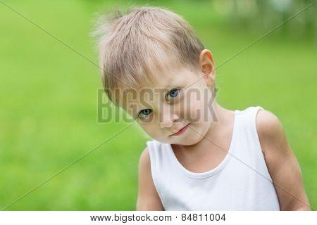 Little blond boy outdoors. Boy three years.